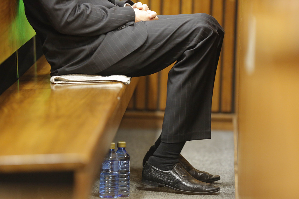 . South African Paralympic athlete Oscar Pistorius sits in the dock during the verdict in his murder trial, Pretoria, South Africa, on September 11, 2014. KIM LUDBROOK/AFP/Getty Images