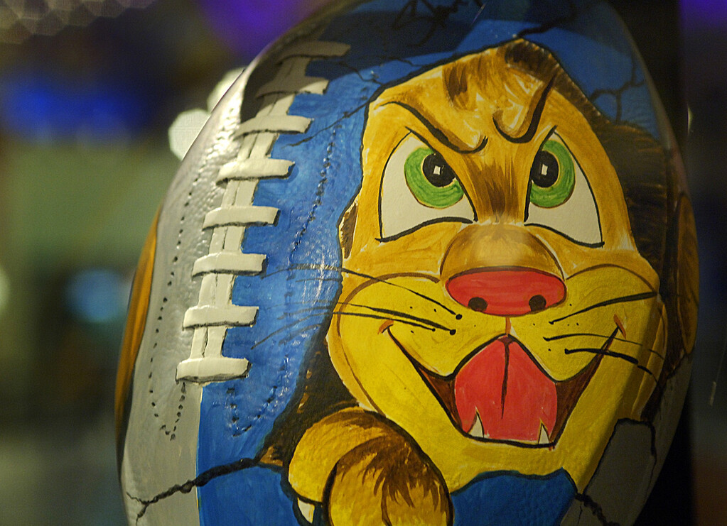 . A plaster football designed by Lion\'s ex-head coach Steve Mariucci is one of many on display inside Great Lakes Crossing Mall for the Celebrity Football Auction to benefit the \'NFL/Youth Education Town - Boys & Girls Club.\'  Photographed Friday January 20, 2006.