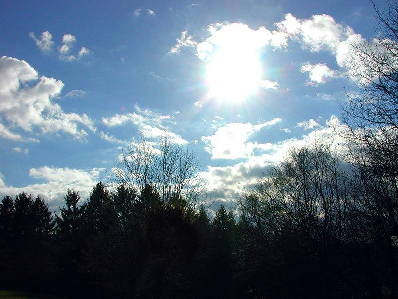 Sun just below a cloud