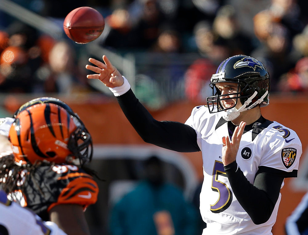 Description of . Baltimore Ravens quarterback Joe Flacco (5) passes against the Cincinnati Bengals in the first half of an NFL football game on Sunday, Dec. 30, 2012, in Cincinnati. (AP Photo/Al Behrman)