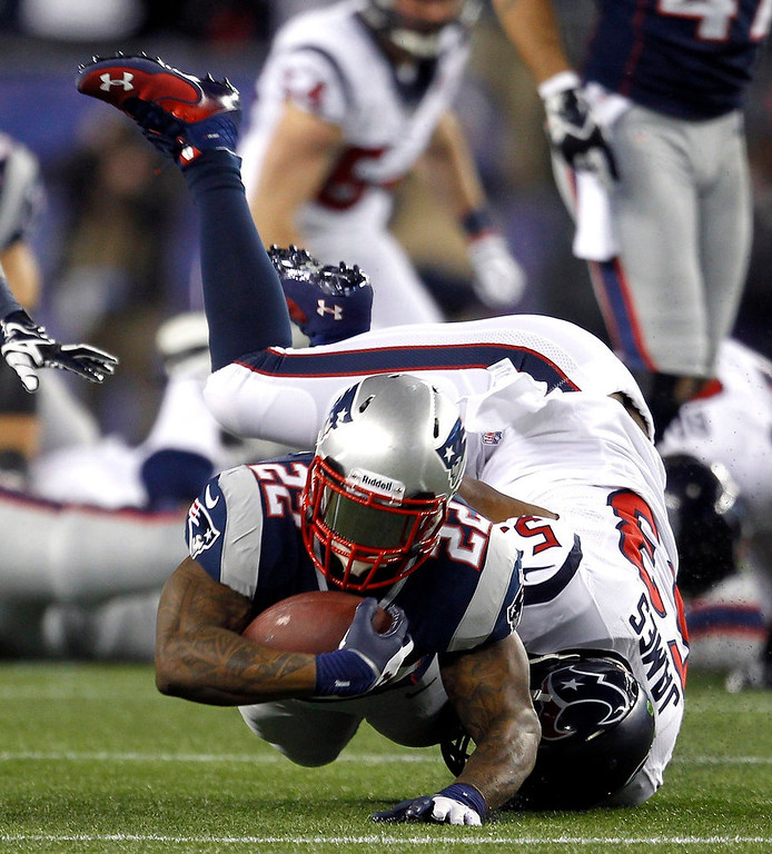. New England Patriots running back Stevan Ridley (22) dives ahead for a first down past the tackle of Houston Texans\' Bradie James (53) during the second quarter of their NFL AFC Divisional playoff football game in Foxborough, Massachusetts January 13, 2013.     REUTERS/Jessica Rinaldi