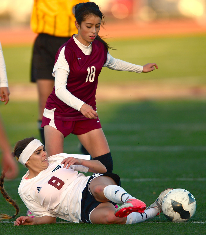 . Torrance\'s Kaitlyn Johnson (8) tries to keep the ball from Downey\'s Jocelyn Maldonado (18) from the ground in a CIF SS Division IV quarterfinal game Thursday at Zamperini Field. Downey won the game 3-1. 20130221 Photo by Steve McCrank / Staff Photographer