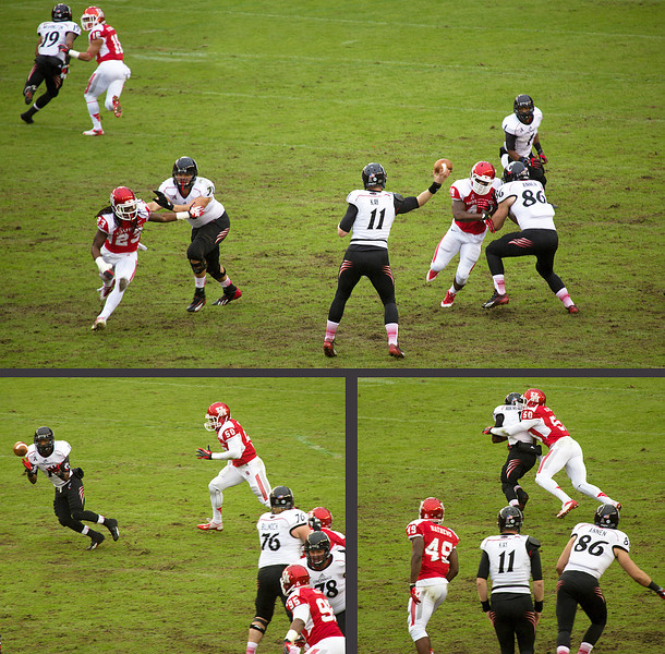 Kay passes to Washington, who is tackled by UH's Oliphant.