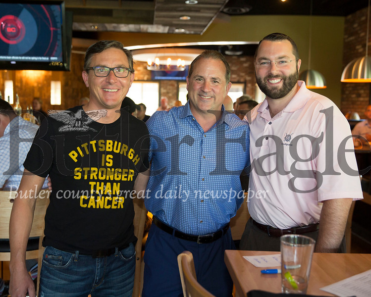 Kirk Vogel, left, Rick Malik and Ethan Nicholas pose for a photo during a recent meeting of the 100+ Men Who Care Pittsburgh group in Wexford