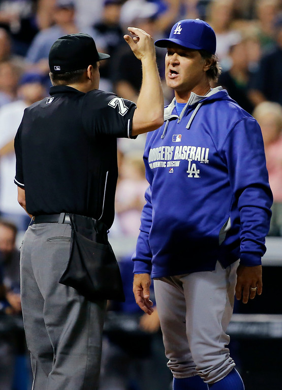 . Los Angeles Dodgers manager Don Mattingly argues with home plate umpire D.J. Reyburn after a collision at home between Justin Turner and Colorado Rockies\' Michael McKenry during the sixth inning of a baseball game Tuesday, Sept. 16, 2014, in Denver. (AP Photo/Jack Dempsey)