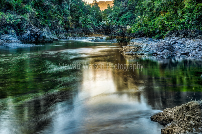 The beautiful Ruamahanga river flowing gently through New Zealand Native bush