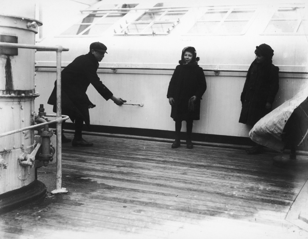 . Three children playing deck quoits on board the Cunard liner Lusitania, June 1912.  (Photo by Topical Press Agency/Hulton Archive/Getty Images)