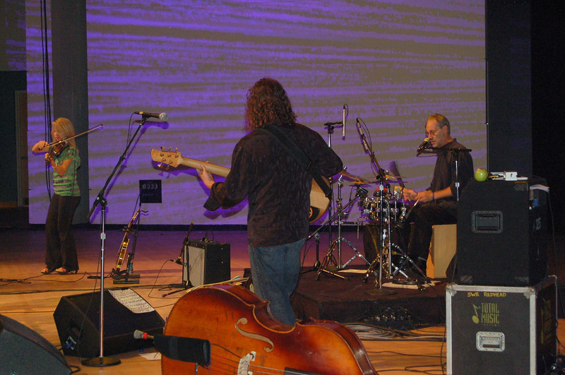 Musicians backing-up Peter Mayer at a benefit concert for the HIV and AIDS Strategy and the Lutheran Malaria Initiative.