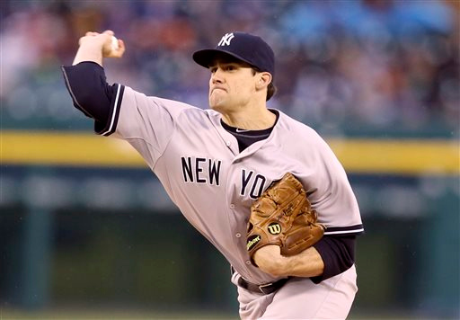 . New York Yankees starting pitcher Nathan Eovaldi throws during the first inning of a baseball game against the Detroit Tigers, Tuesday, April 21, 2015, in Detroit. (AP Photo/Carlos Osorio)