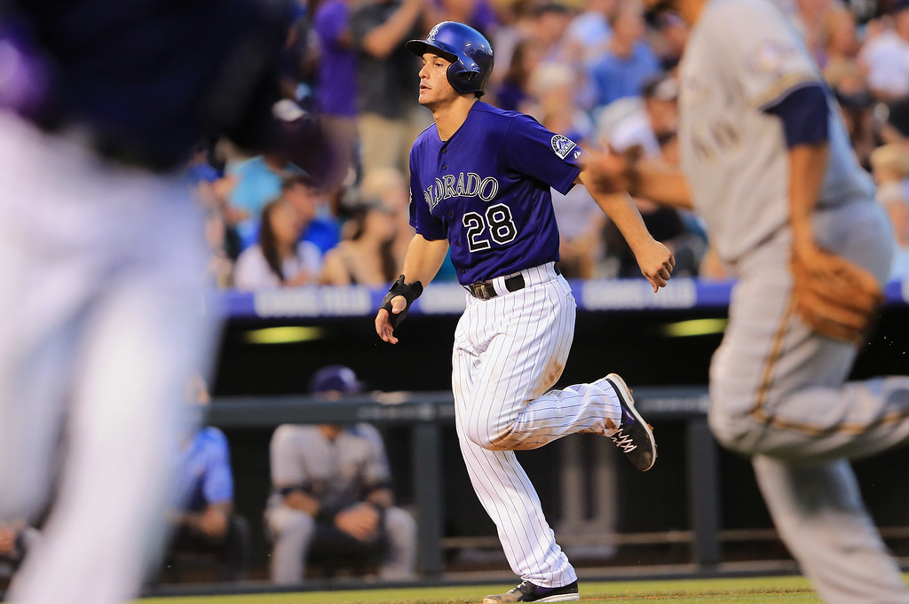 . DENVER, CO - JULY 26:  Nolan Arenado #28 of the Colorado Rockies heads home to score on a single by Troy Tulowitzki #2 of the Colorado Rockies off of \\mb60 in the fourth inning at Coors Field on July 26, 2013 in Denver, Colorado.  (Photo by Doug Pensinger/Getty Images)