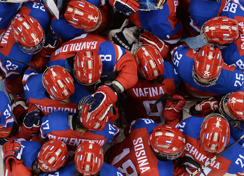 . Russian team members celebrate after beating Japan in the Women\'s Ice Hockey Group B match at the Shayba Arena during the Sochi Winter Olympics on February 11, 2014.  (JONATHAN NACKSTRAND/AFP/Getty Images)