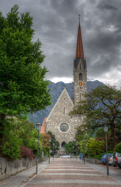 Heavy clouds above Vaduz Cathedral in Vaduz, Liechtenstein