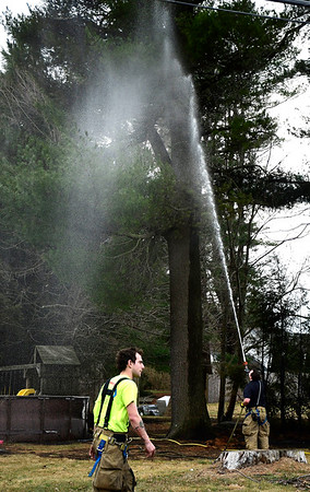 3/10/2020 Mike Orazzi   Staff Terryville firefighters while on scene of a grass fire that extended to two homes on Sandra Avenue on Tuesday afternoon.