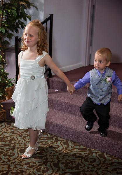 Grace and Little Groomsmen entering ballroom.jpg