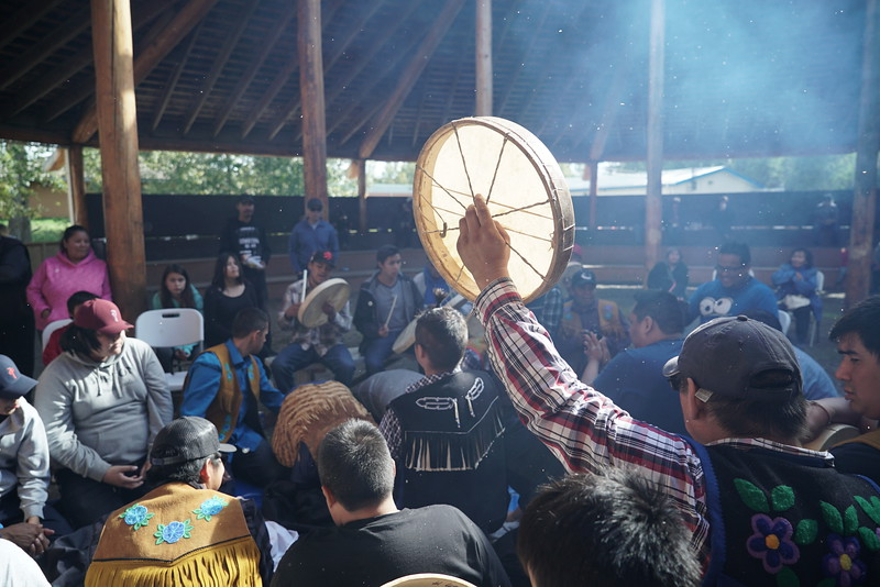 Warming up drum in sun during hand game match.