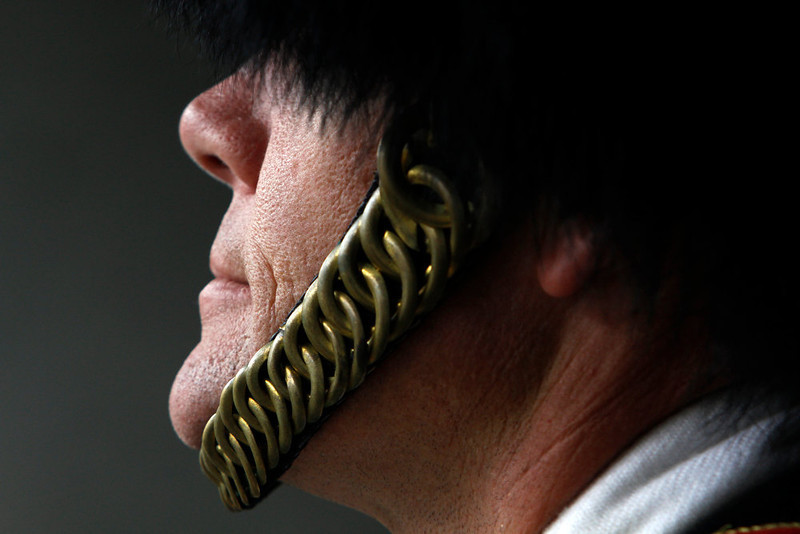 . Todd Nix, Chief Musician and Head Drum Major for Navy, waits in the tunnel with before marching on the field before the start of the 113th Army Navy football game in Philadelphia Saturday Dec. 8, 2012.  (AP Photo/Jacqueline Larma)