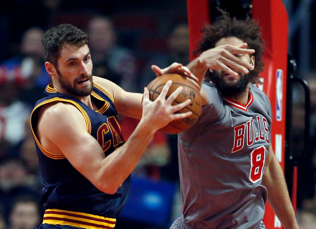 . Cleveland Cavaliers forward Kevin Love, left, rebounds the ball next to Chicago Bulls center Robin Lopez during the first half of an NBA basketball game Friday, Dec. 2, 2016, in Chicago. (AP Photo/Nam Y. Huh)