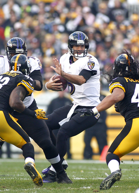 . Joe Flacco #5 of the Baltimore Ravens is hurried against the Pittsburgh Steelers during the game on October 20, 2013 at Heinz Field in Pittsburgh, Pennsylvania.  (Photo by Justin K. Aller/Getty Images)