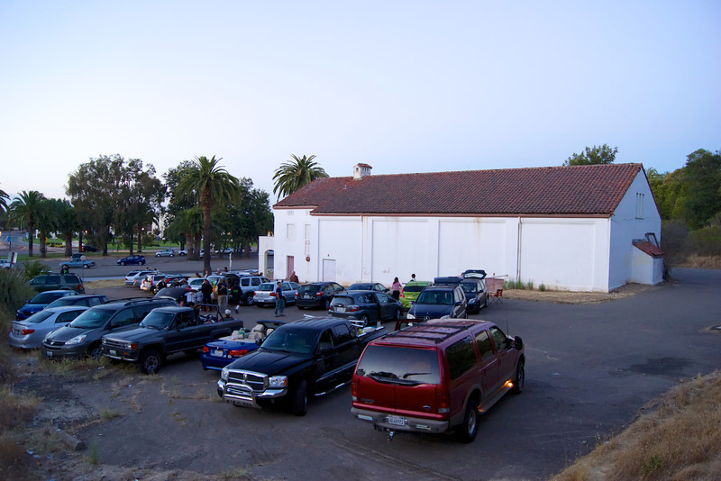Movie goers arrive at a makeshift drive-in theater