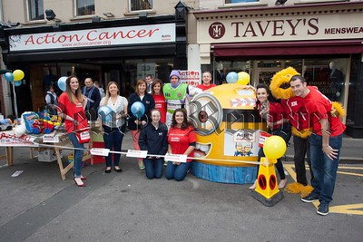 Staff from MJM Marine pictured outside the Action Cancer shop on HIll Street which they worked at for the day to raise much needed funds for the charity. R1539019