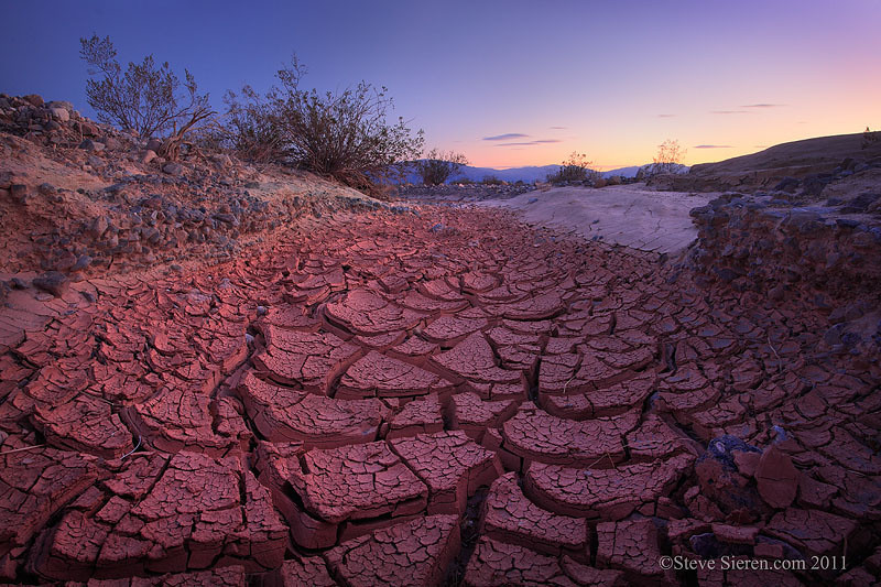 Cracked mud in a dried up desert stream in Death Valley
