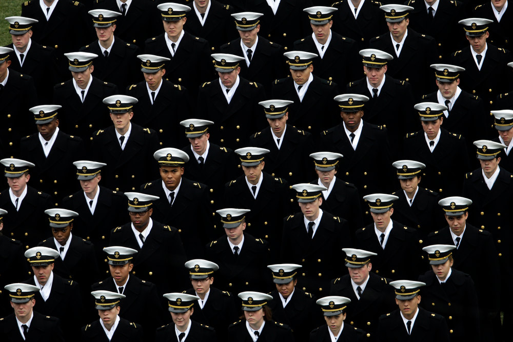 . Navy Midshipmen march onto the field before an NCAA college football game between the Army and the Navy Saturday, Dec. 8, 2012, in Philadelphia. (AP Photo/Matt Rourke)