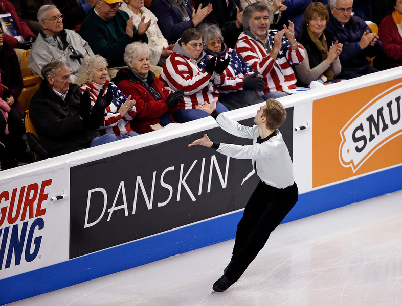 . Douglas Razzano competes in the men\'s free skate at the U.S. Figure Skating Championships in Boston, Sunday, Jan. 12, 2014. (AP Photo/Elise Amendola)