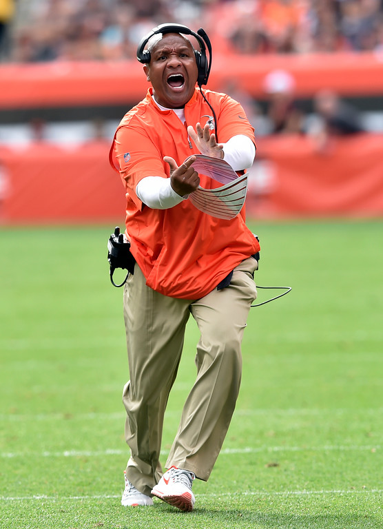 . Cleveland Browns head coach Hue Jackson tries to get a timeout during the second half of an NFL football game against the New York Jets, Sunday, Oct. 8, 2017, in Cleveland. (AP Photo/David Richard)