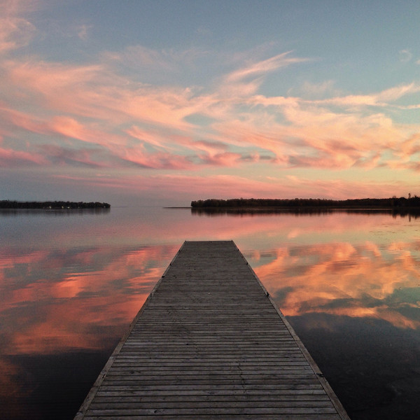 Looking south from Orillia the reflection of an Autumn sunset is reflected in Lake Simcoe