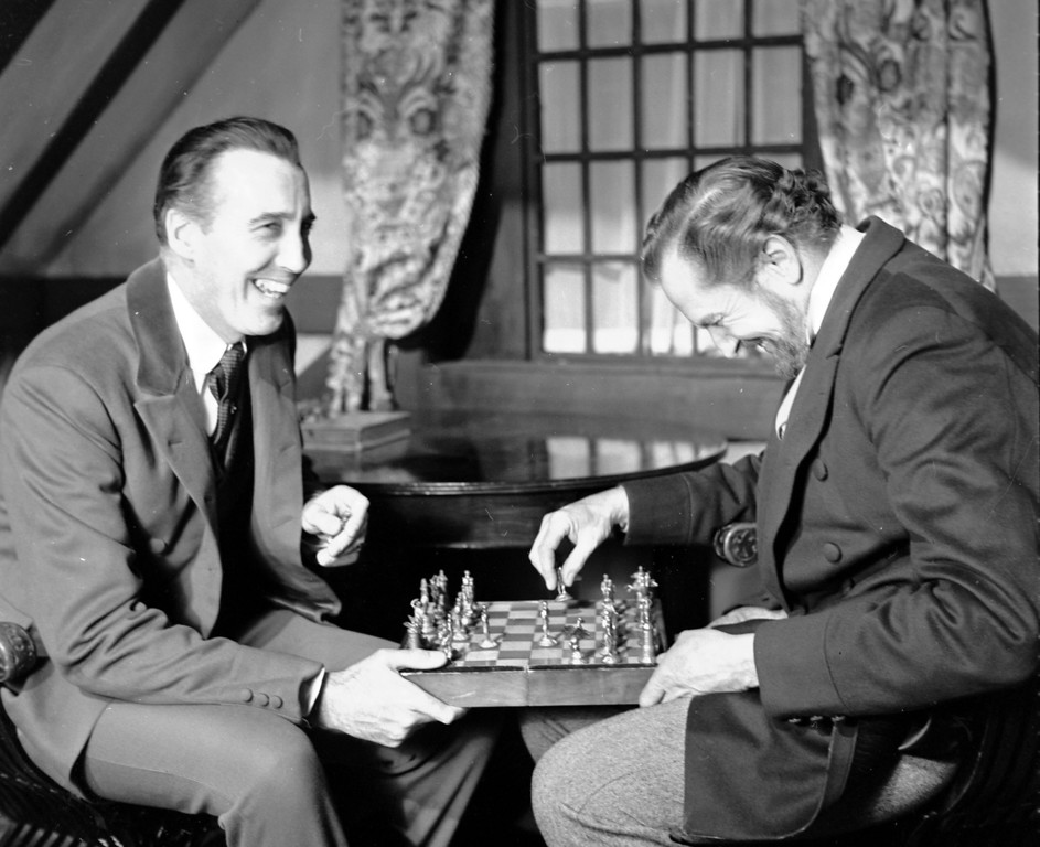 ". In this file photo dated Dec. 17,1968, British actor Christopher Lee, left and American actor Vincent Price, share a joke whilst playing chess during a break in the filming of Edgar Allen Poe\'s ""The Oblong Box\"", at Shepperton Studios, England. (AP Photo/Bob Dear, FILE)"