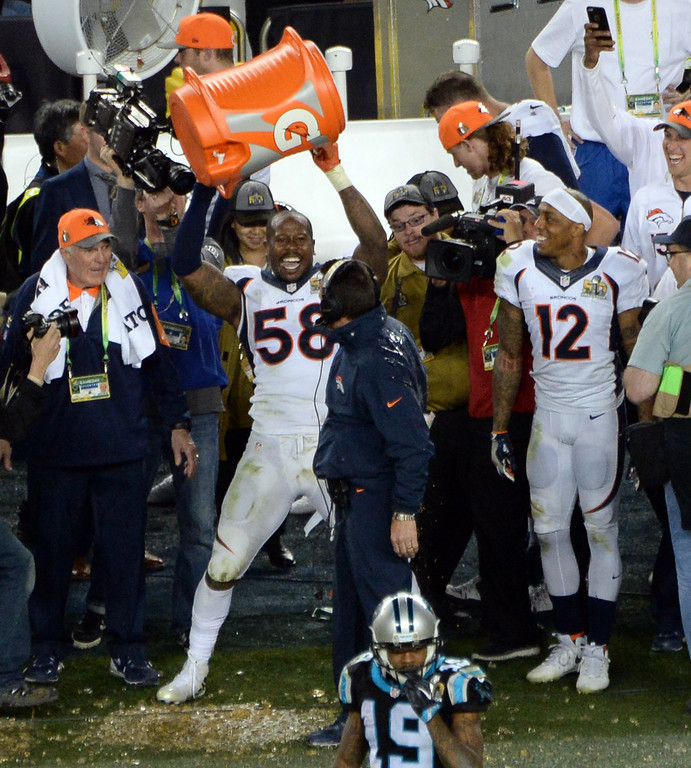 . SANTA CLARA, CA - FEBRUARY 7: Von Miller (58) of the Denver Broncos holds up the cooler in triumph after he dumped Gatorade on head coach Gary Kubiak of the Denver Broncos as the Broncos win the Super Bowl.  The Broncos defeated the Panthers 24 to 10 in Super Bowl 50. The Denver Broncos played the Carolina Panthers in Super Bowl 50 at Levi\'s Stadium in Santa Clara, Calif. on February 7, 2016. (Photo by RJ Sangosti/The Denver Post)