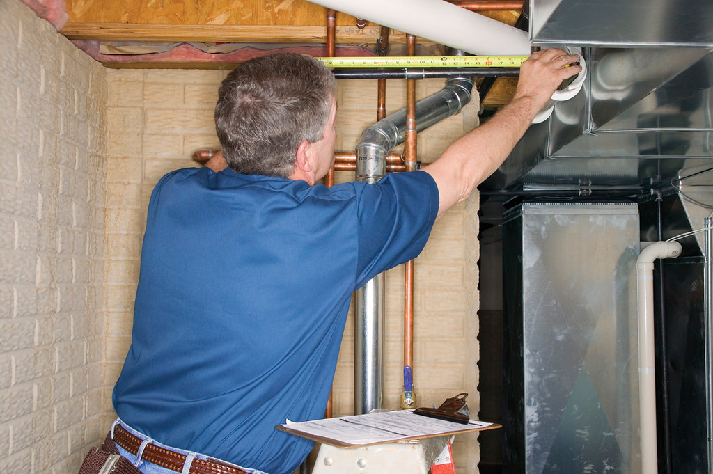 . Have your heating system serviced professionally to make sure that it is clean, working properly and ventilated to the outside. (Metro Creative Connection)