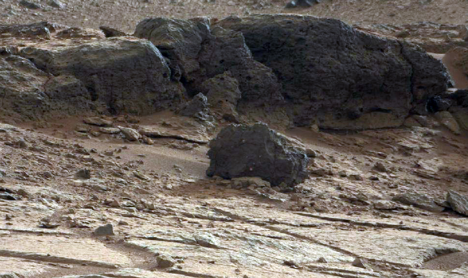Description of . FILE - This image provided by NASA shows a rock outcrop in Gale Crater on Mars. (AP Photo/NASA)