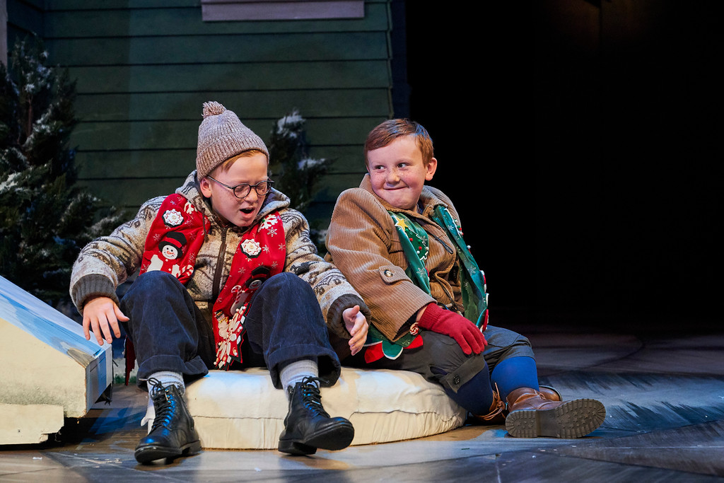 ". Ralphie (Jake Spencer) and Randy (Sam Spencer) star in the Cleveland holiday favorite, ""A Christmas Story.\"" The Cleveland Play House production is on stage at Playhouse Square\'s Allen Theatre through Dec. 23. For more information, visit www.clevelandplayhouse.com.  (Roger Mastroianni)"