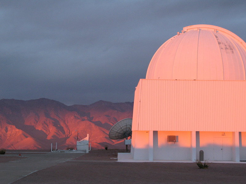 0.9m telescope illuminated by the setting sun