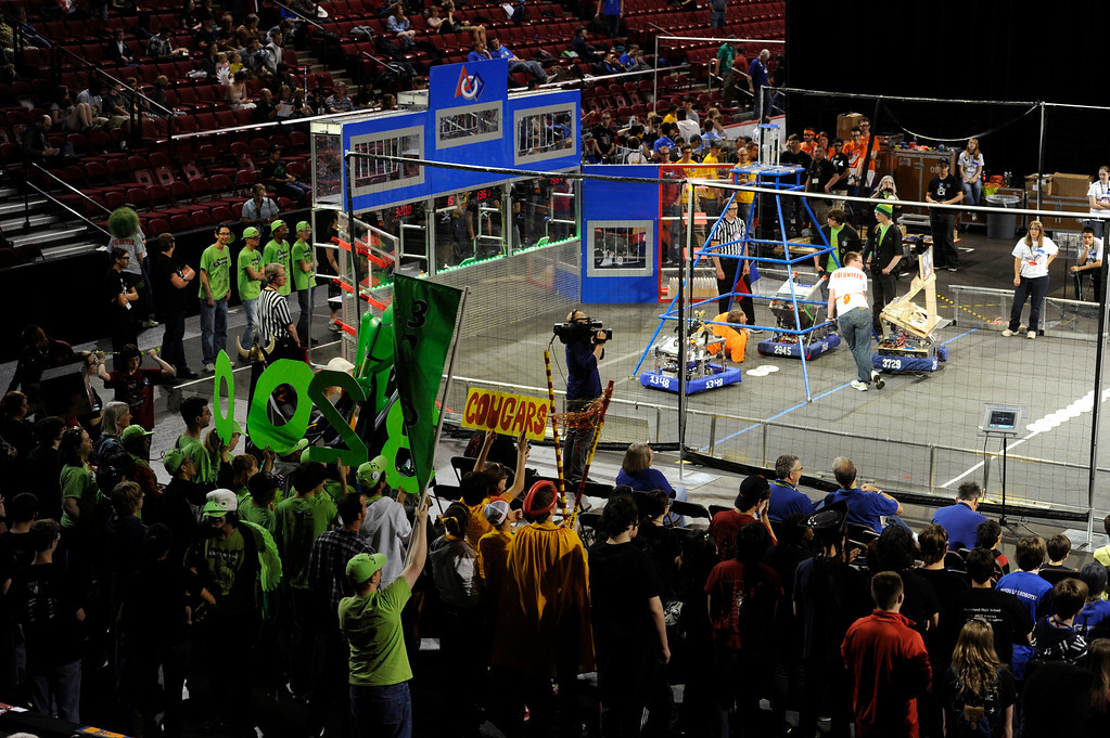 . DENVER, CO.- APRIL 6: A large cheering section forms just outside the competition arena. The Colorado Regional FIRST Robotics Competition takes place in Magness Arena inside the Ritchie Center on the University of Denver campus. High School students from all over the state, region, and even a team from Mexico, participate in a high-tech spectator sporting event (this year the teams used frisbees) using specially engineered robots that are maneuvered by human drivers using computers and joy sticks.(Photo By Kathryn Scott Osler/The Denver Post)