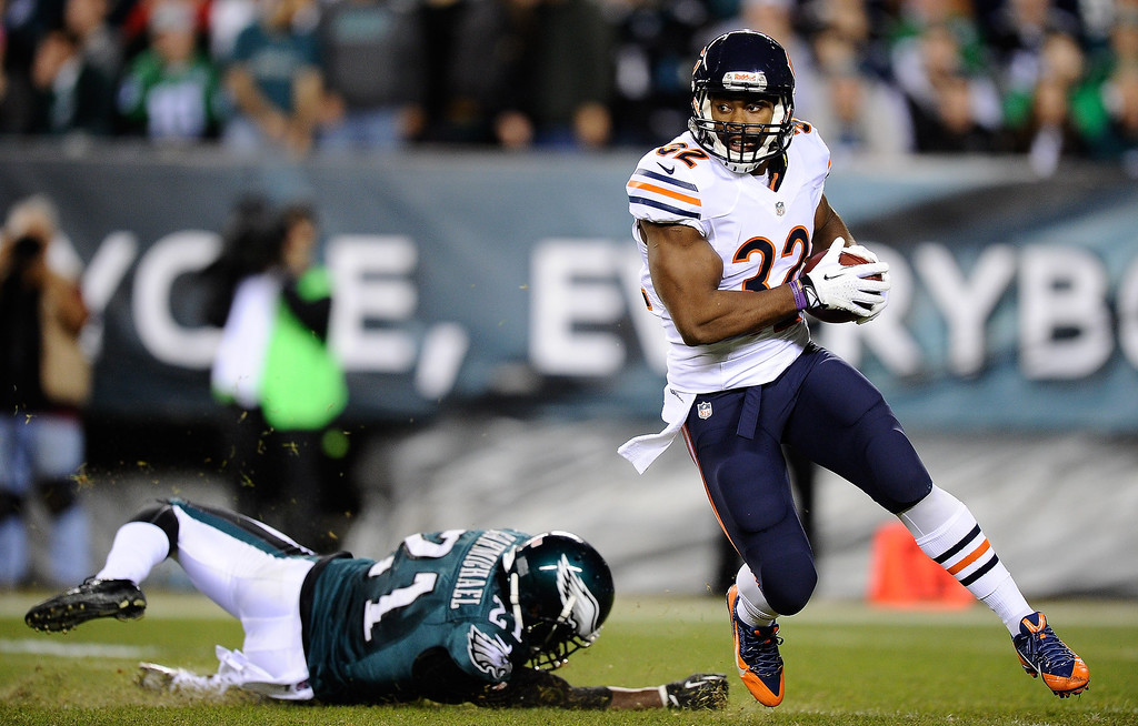 . Michael Ford #32 of the Chicago Bears carries the ball past Roc Carmichael #21 of the Philadelphia Eagles during the second quarter at Lincoln Financial Field on December 22, 2013 in Philadelphia, Pennsylvania.  (Photo by Maddie Meyer/Getty Images)