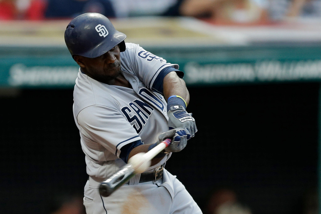 . San Diego Padres\' Jose Pirela hits a one-run triple off Cleveland Indians starting pitcher Trevor Bauer in the fifth inning of a baseball game, Wednesday, July 5, 2017, in Cleveland. Luis Torrens scored on the play. (AP Photo/Tony Dejak)