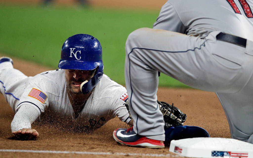 . Kansas City Royals\' Whit Merrifield, left, is tagged out by Cleveland Indians third baseman Jose Ramirez during the eighth inning of a baseball game at Kauffman Stadium in Kansas City, Mo., Wednesday, July 4, 2018. Merrifield was caught stealing. (AP Photo/Orlin Wagner)