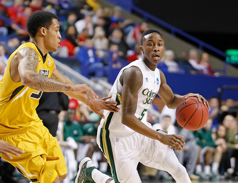. Colorado State\'s Jon Octeus drives past a Missouri defender during the first half in their second round NCAA basketball game at the Rupp Arena in Lexington, Kentucky, March 21, 2013. REUTERS/ Megan Stearman