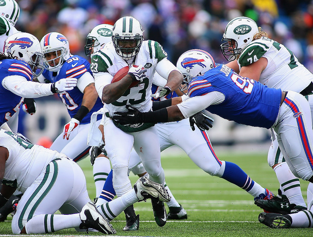 . Shonn Greene #23 of the New York Jets runs against the Buffalo Bills at Ralph Wilson Stadium on December 30, 2012 in Orchard Park, New York.  (Photo by Rick Stewart/Getty Images)