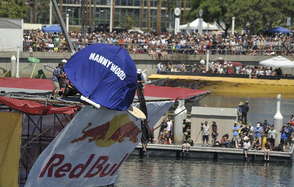 """. LONG BEACH, CALIF. USA -- Flugtag entry \""""Mannywood\"""" gets stuck on the ramp in Rainbow Harbor in Long Beach, Calif. on August 21, 2010. Thirty five teams competed in the Red Bull event where teams build homemade, human-powered flying machines and pilot them off a 30-foot high deck in hopes of achieving flight.  Flugtag means \""""flying day\"""" in German. They are on distance, creativity and showmanship..Photo by Jeff Gritchen / Long Beach Press-Telegram.."""