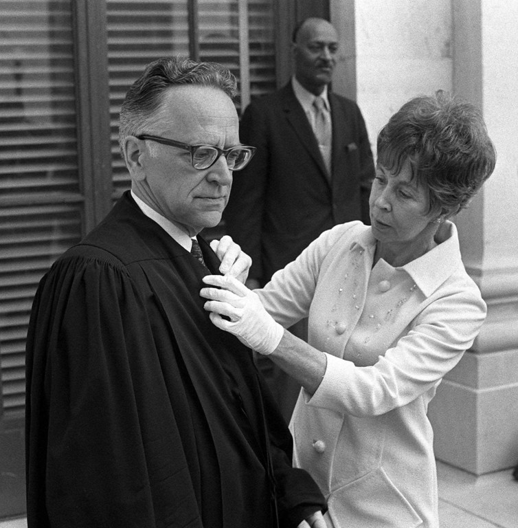 . Supreme Court Justice Harry Blackmun has his robe adjusted by his wife after taking his oath to join the high court in this June 9, 1970 photo.  (AP Photo)