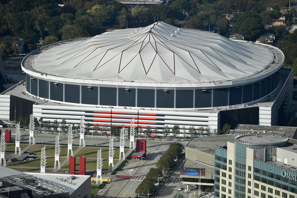 . FILE- This Nov. 1, 2017, file photo shows the Georgia Dome in Atlanta. The Georgia Dome is scheduled to be imploded Monday, Nov. 20. The dome was not only the former home of the Atlanta Falcons but also the site of two Super Bowls, 1996 Olympics Games events and NCAA basketball tournaments among other major events. (AP Photo/Mike Stewart, File)