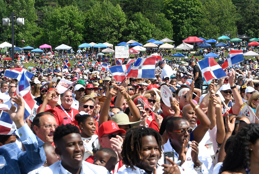 . Fans cheer for National Baseball Hall of Fame inductee Vladimir Guerrero during his induction ceremony at the Clark Sports Center on Sunday, July 29, 2018, in Cooperstown, N.Y. (AP Photo/Hans Pennink)