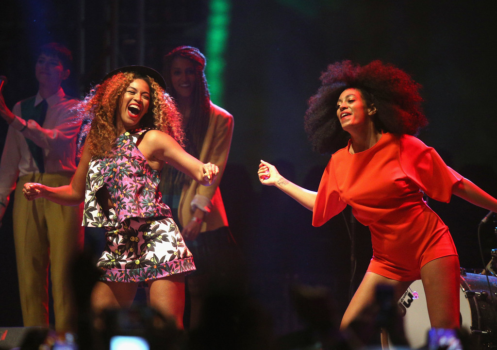 . Singers Beyonce (L) and Solange perform onstage during day 2 of the 2014 Coachella Valley Music & Arts Festival at the Empire Polo Club on April 12, 2014 in Indio, California.  (Photo by Imeh Akpanudosen/Getty Images for Coachella)