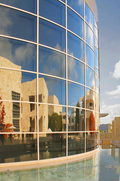 The Getty Reflected ~ I went on a photo shoot to the Getty Center in Los Angeles, and came back with shots of many architectural details.  The Getty is a massive museum and research center.  I spent most of my time outside or shooting inside, rather than visiting most of the galleries.  This image is one of the main buildings, reflected in the curved window of another.