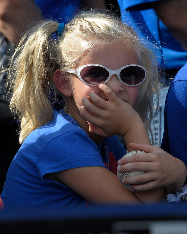 . A young Royals fan watches batting practice before the start of a baseball game between the Kansas City Royals and the Cleveland Indians Saturday, Sept. 20, 2014, in Kansas City, Mo. (AP Photo/Reed Hoffmann)