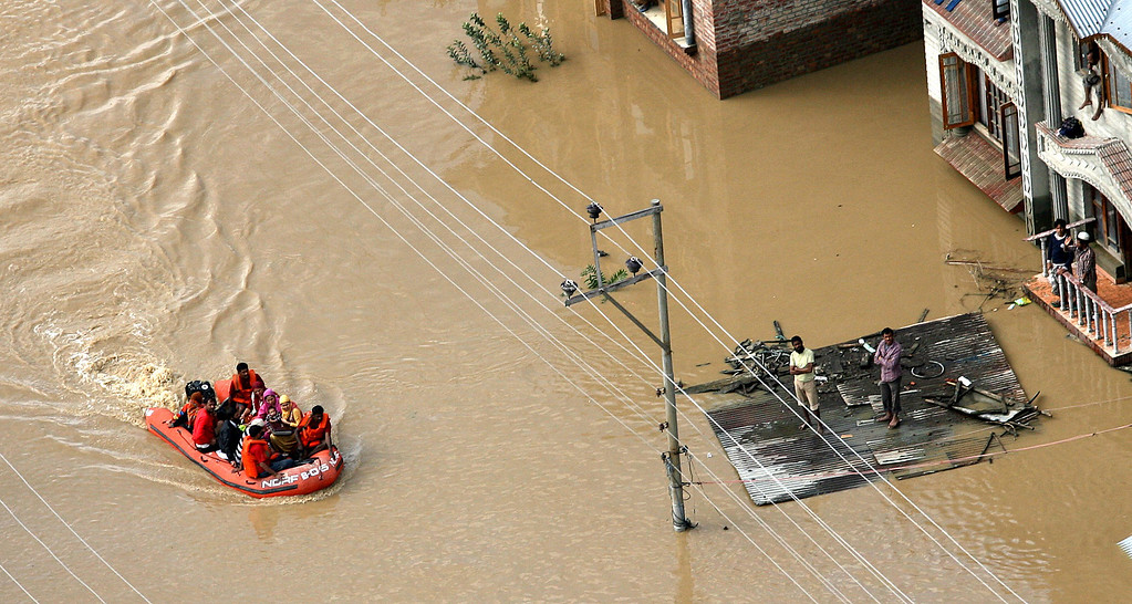 . In this handout photograph released by Ministry of Defense on September 10, 2014, a National Disaster Response Force (NDRF) team rescues stranded civilians in the flood affected part of Srinagar.  AFP PHOTO/MINISTRY OF DEFENCE/AFP/Getty Images