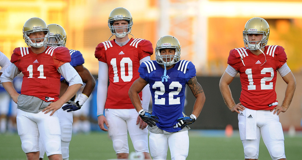 . Players look on during spring practice Monday April 7, 2014 at UCLA.(Andy Holzman/Los Angeles Daily News)